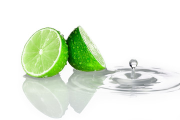 Two slices of lime with water drop