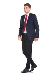 Full body of a young business man walking