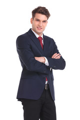young business man holding his hands crossed.
