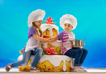 The children confectionery baked a big cake with roses