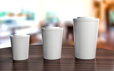Cups of different sizes on cafe table