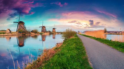 Acrylic Prints Mills Dutch windmills on canak at Kinderdijk