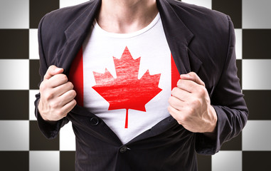 Businessman stretching suit with Canada Flag on checkered