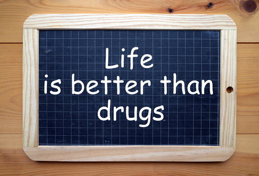 The words Life is Better Than Drugs in white text on a blackboard