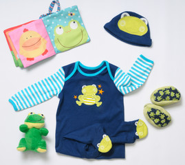 top view fashion trendy look of baby boy clothes and funny frog