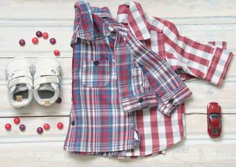 top view fashion trendy look of baby boy shirts with toy and swe