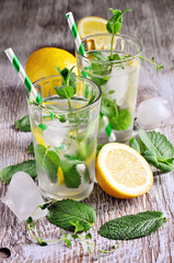 Refreshing cold iced mint tea with lemons, summer drink with ice