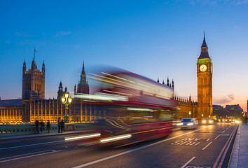 Spoed Foto op Canvas Londen rode bus Iconic Double Decker bus with Big Ben and Parliament at blue hour, London, UK