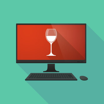 Personal computer with a glass of wine