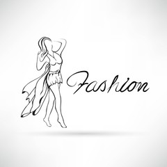 Beautiful woman model walking on the runway, shows the dress