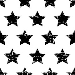 Hand drawn vector seamless pattern with black stars isolated on