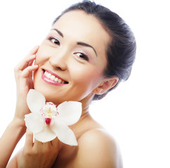 Beautiful woman face with orchid flower