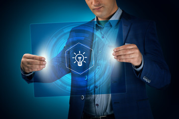 Businessman holding a transparent screen with an icon. Business,