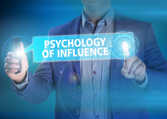 Businessman presses button psychology of influence on virtual sc