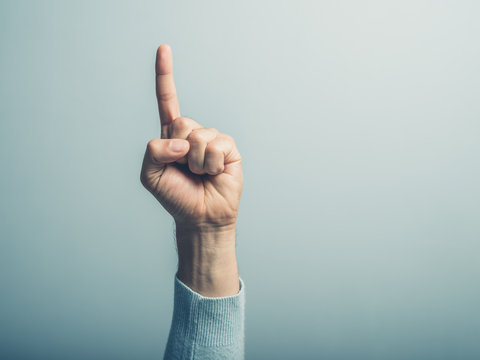 Male hand with finger pointing up