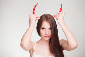 woman horned with chili peppers