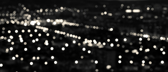 abstract white black circular bokeh background, city lights in t