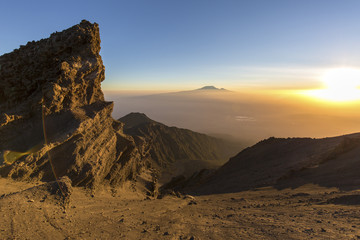 Sunrise on Mount Meru with Mt Kilimanjaro in the distance, near Arusha in Tanzania. Africa.