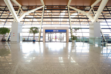 Modern airport interior glass wall aisle window and door