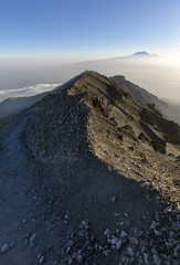 Views over to Mt Kilimanjaro from Mt Meru in Tanzania, Africa.