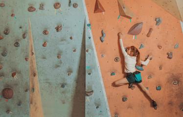Little girl climbing indoor