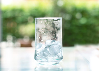 the ice cube in glass that out of water