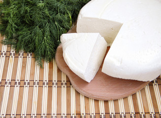 feta cheese with herbs on wooden background