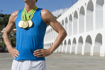 Athlete with Gold Medals Standing at Lapa Rio de Janeiro