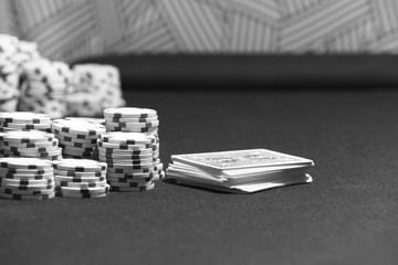 Poker cards and betting chips in a table game