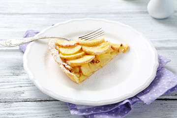 Slice of tart with apples on a plate