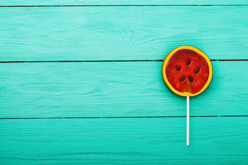 Sweet candy on blue wooden background