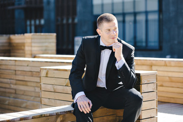 Maxim photo session model in tuxedo outdoors