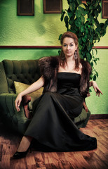 Beautiful Lady Sitting in Armchair