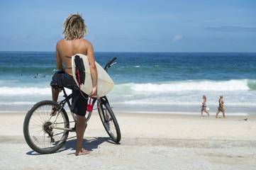Brazilian Surfer on Bike Ipanema Beach Rio Brazil