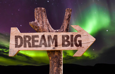 Dream Big direction sign with aurora borealis background