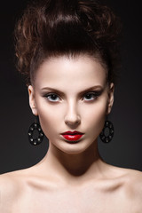 Beautiful brunette girl with evening make-up and perfect skin