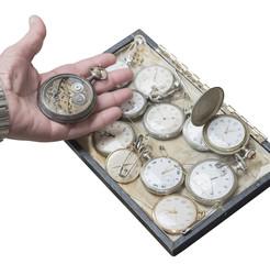 clockwork old pocket watch in a hand
