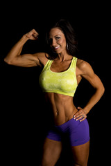 woman blue shorts and green sports bra on black flex look