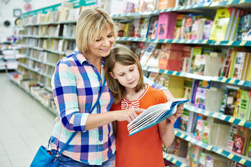 Mother and daughter chooses a book