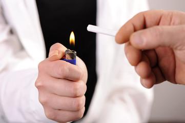 Hand Holding a Lighter