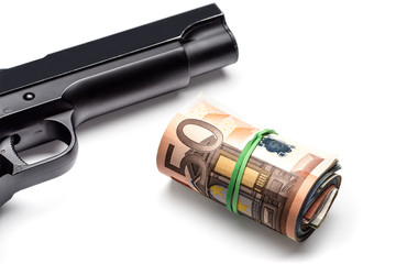 Bunch of euro banknotes with a gun