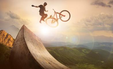 Sport. Motion biker jumps Wall mural