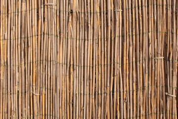 A wooden background with vertical reeds