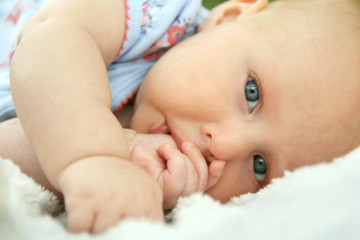 Newborn Baby Girl Laying Down Sucking Her Thumb