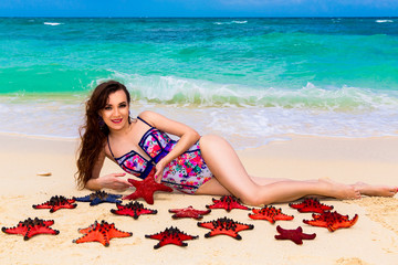 beautiful young brunette enjoying the sun on the tropical coast