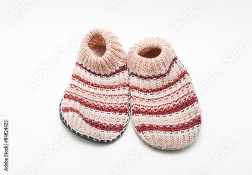 efd2a1a42d0 Closeup view of gorgeous styled fashionable cozy knit slippers isolated on  white background
