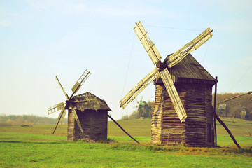 two ancient windmills on the field