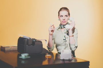 Calling retro 50s young blonde secretary woman sitting behind de