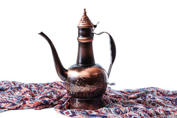 Eastern jug on a brown draped cloth
