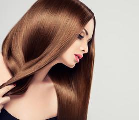 Beautiful girl with brown hair .Long straight hair Shine